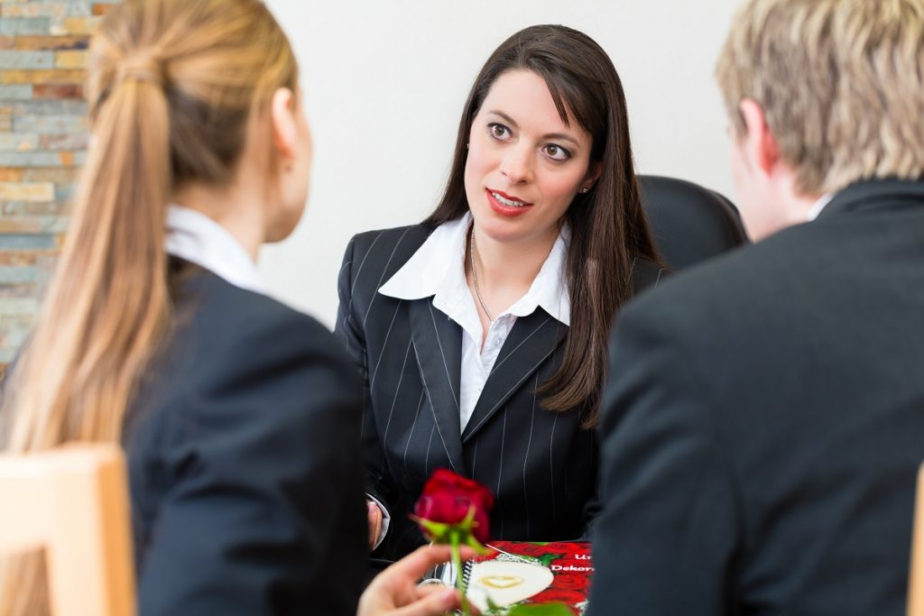 Woman consulting agent for a funeral plan