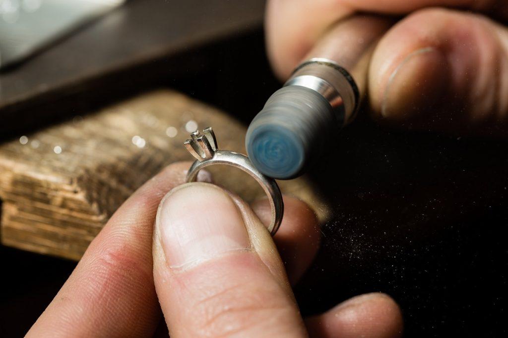 Jeweler repairing a ring