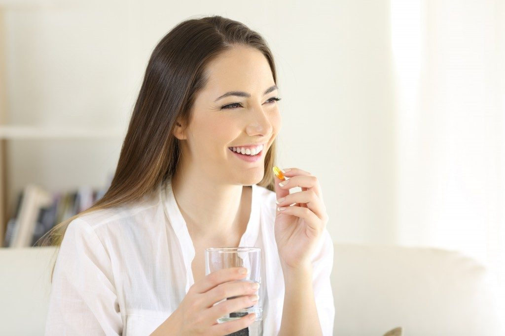 Woman drinking supplement