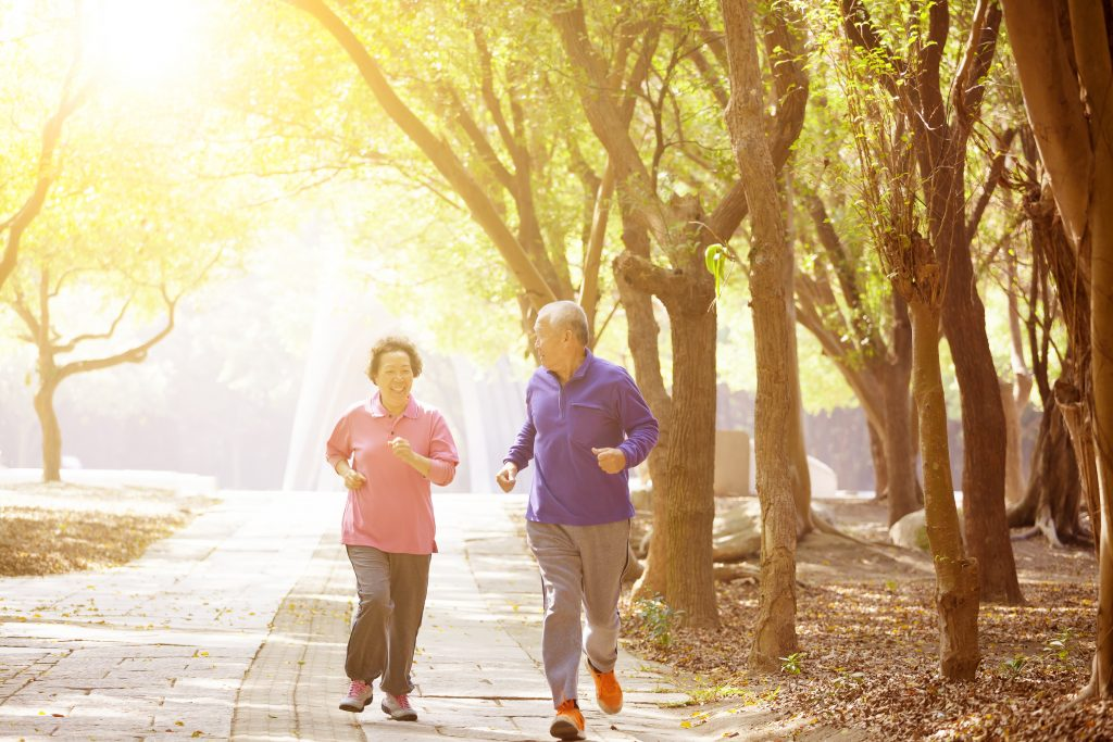 old couple jogging in the morning