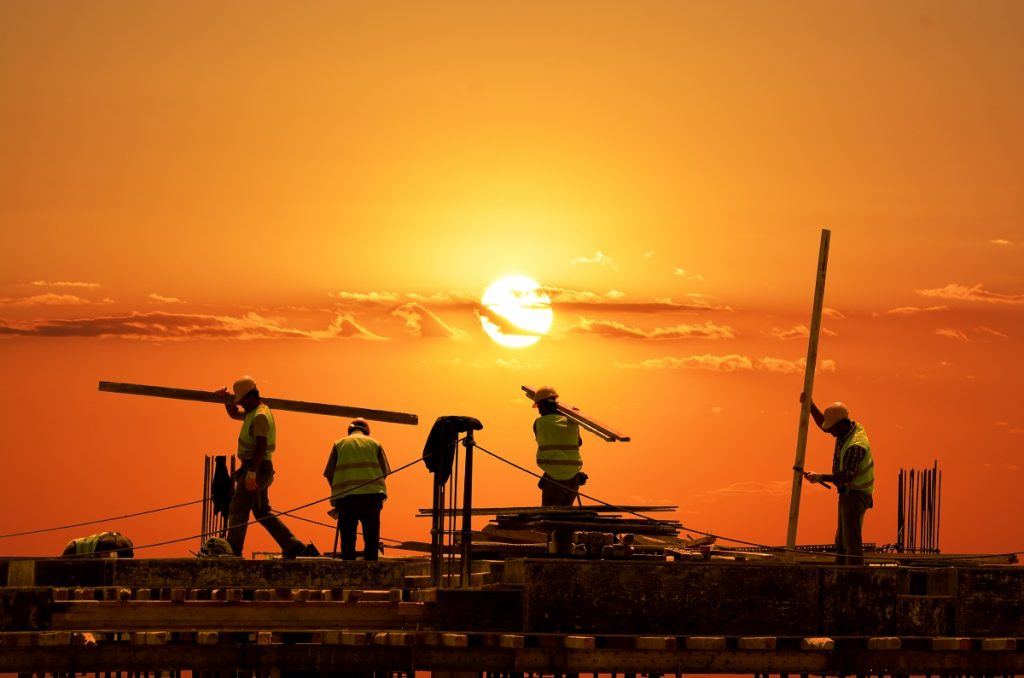 Men working during the sunset