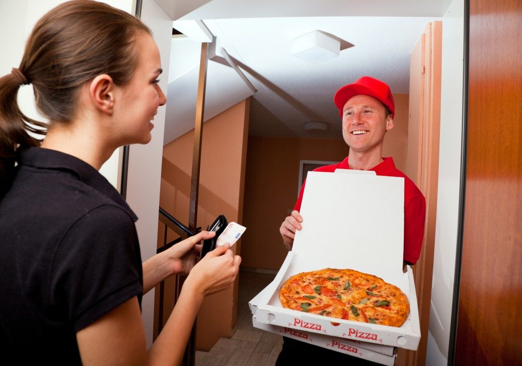 Woman receiving her pizza delivery
