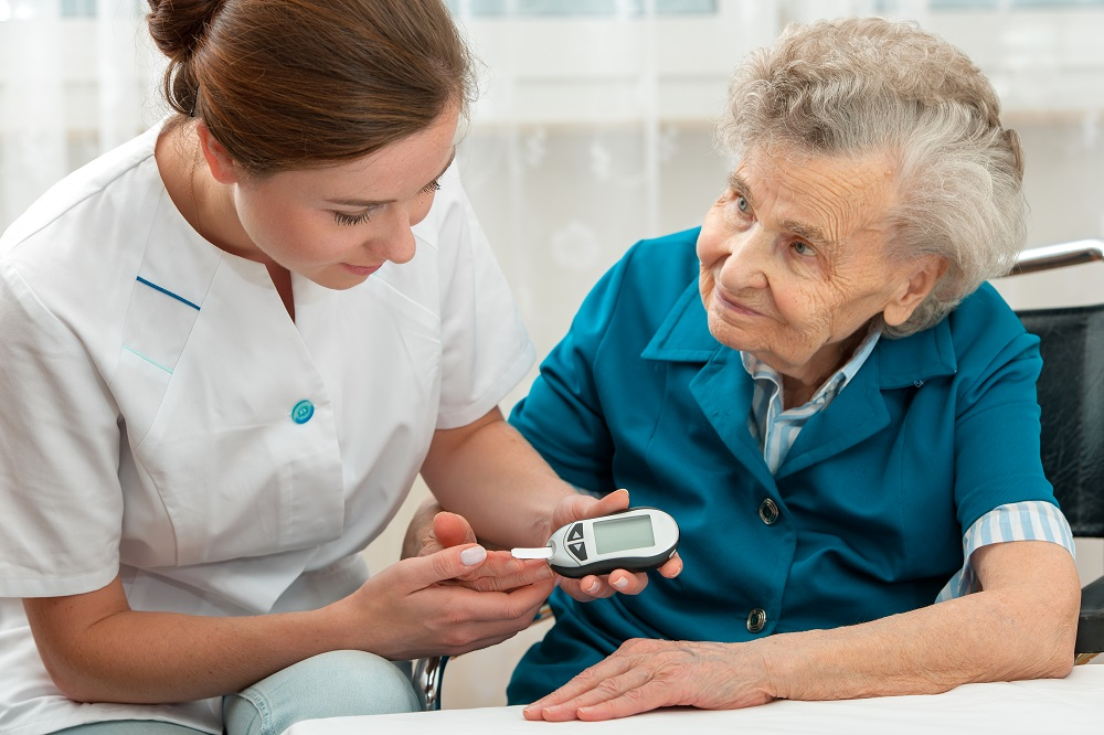elderly woman getting blood sugar check