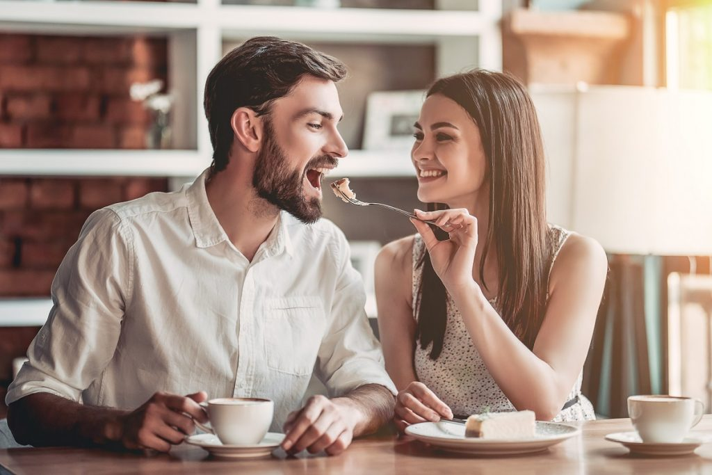 Sweet couple sharing a snack