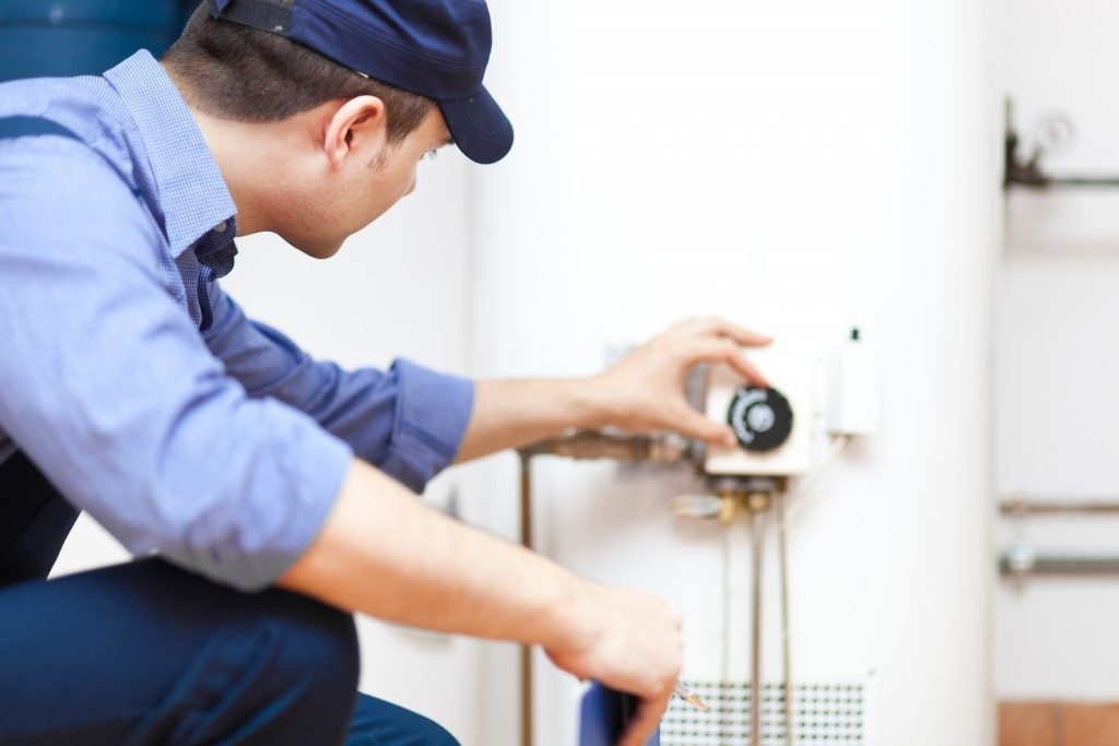 Plumber repairing the water heater