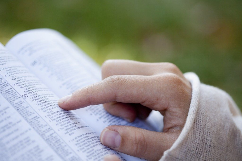 Hands going through the bible