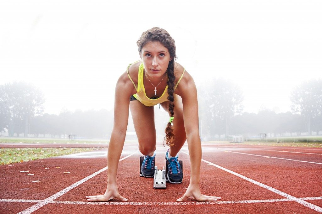 Athlete woman at the track field