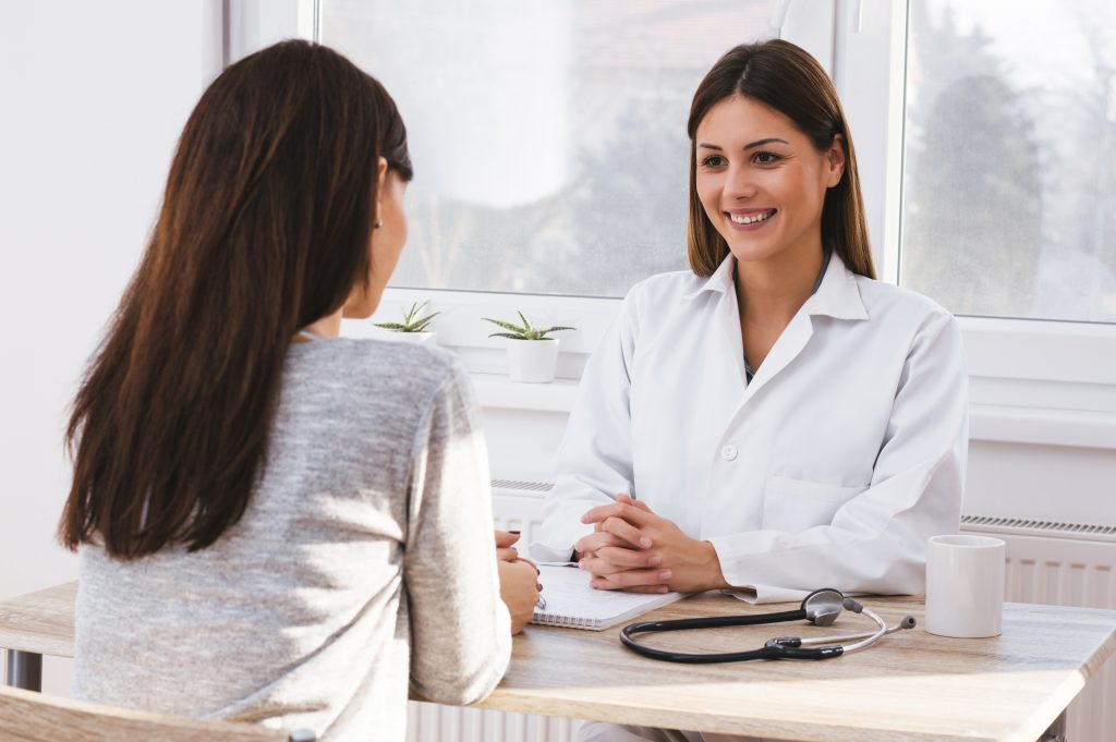 Woman consulting with her OB-GYN