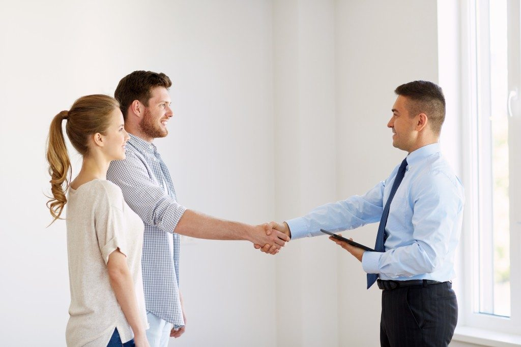 realtor shaking hands with a man