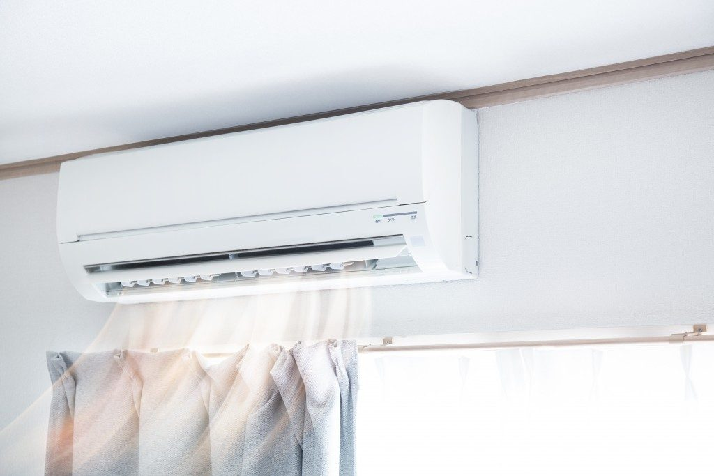 Air conditioner blowing warm air