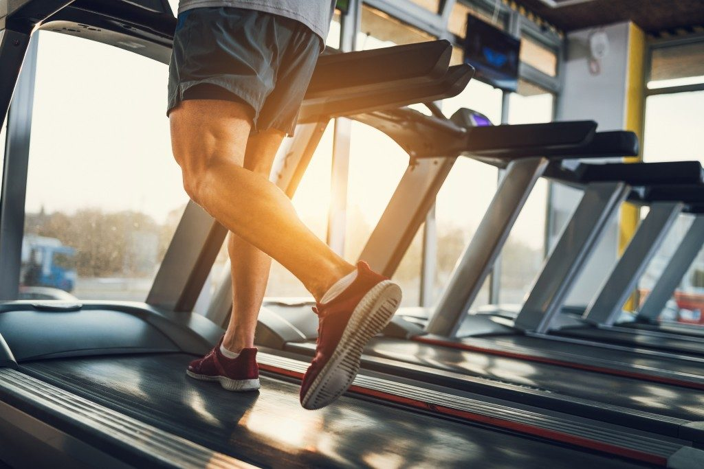 man running on an inclined treadmill