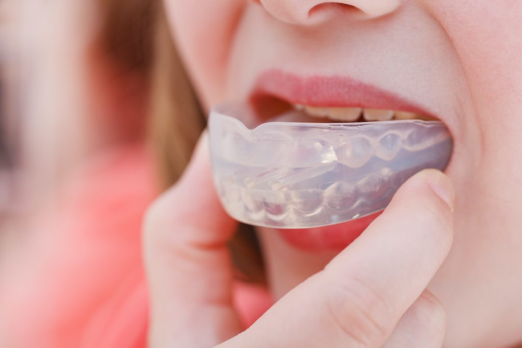 woman using invisalign braces