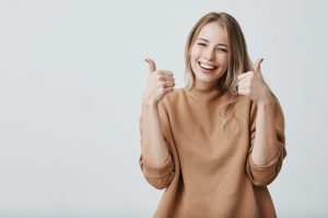 woman giving a thumbs up