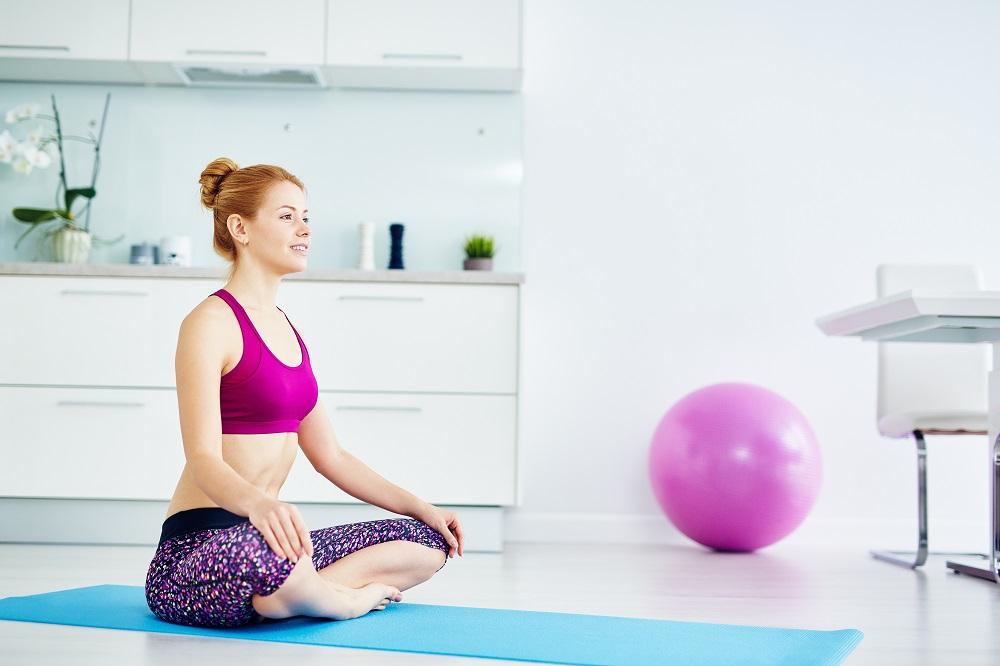 woman meditating at home