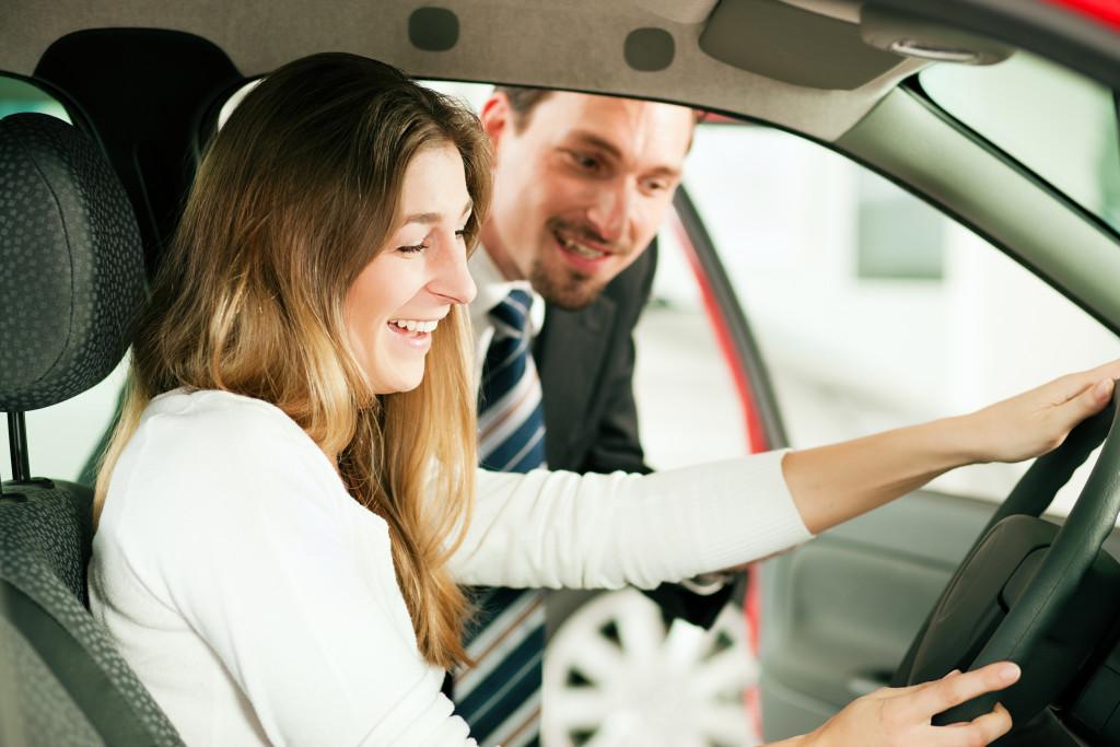 woman testing a car