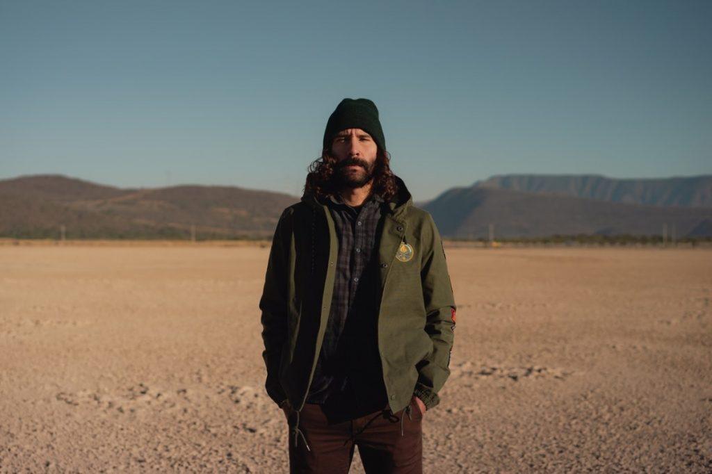 man standing on a desert