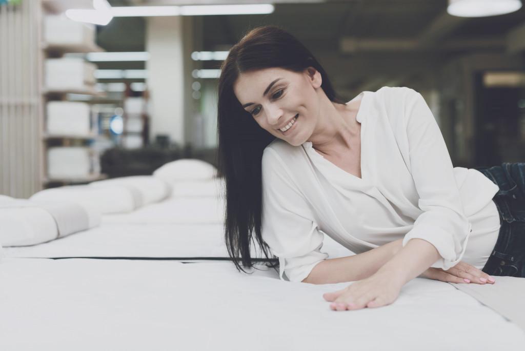 woman checking bedding