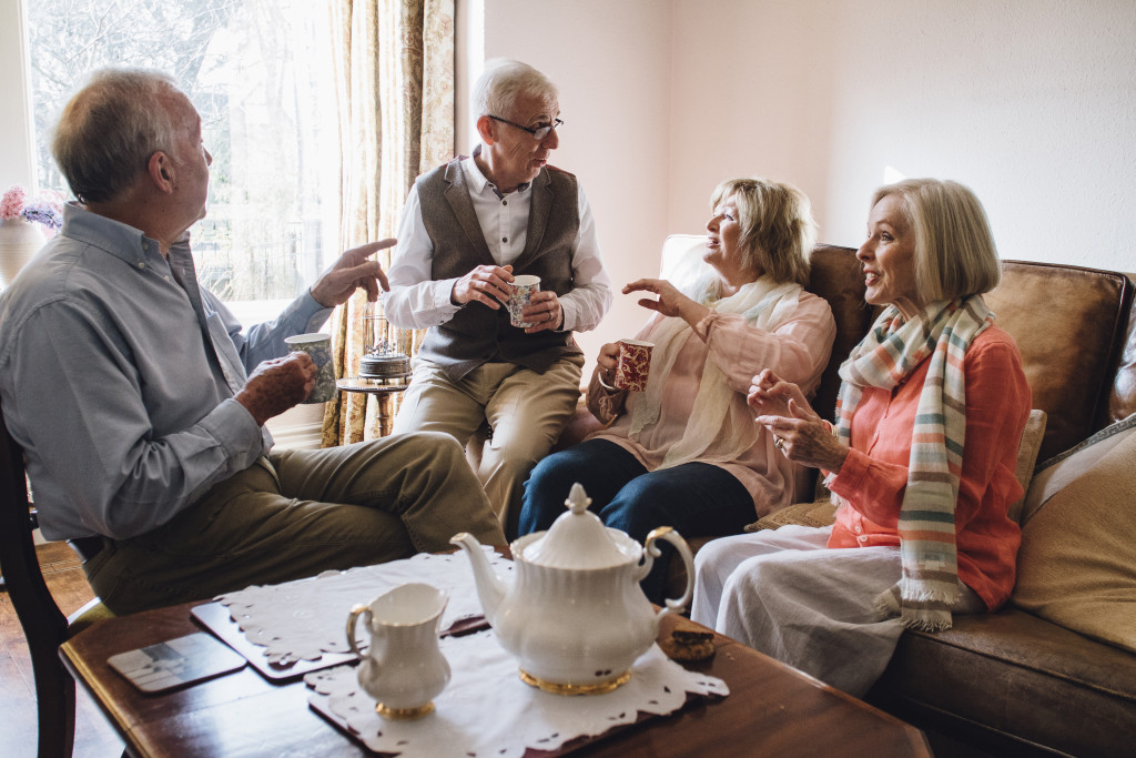 old people having a tea party