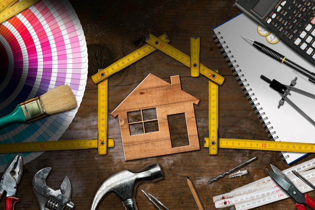 art materials gathered around a house cardboard
