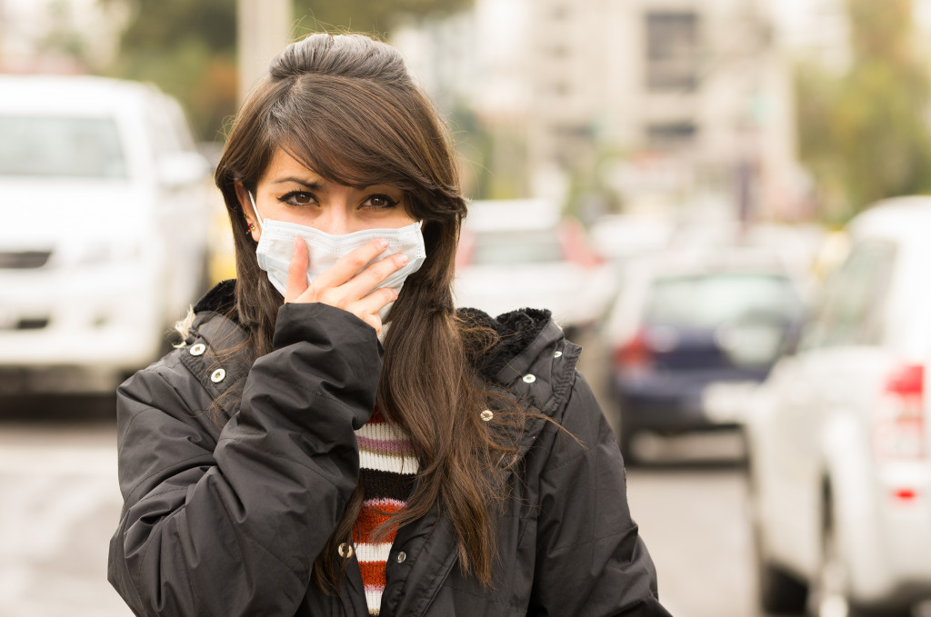 woman wearing a facemask outdoors